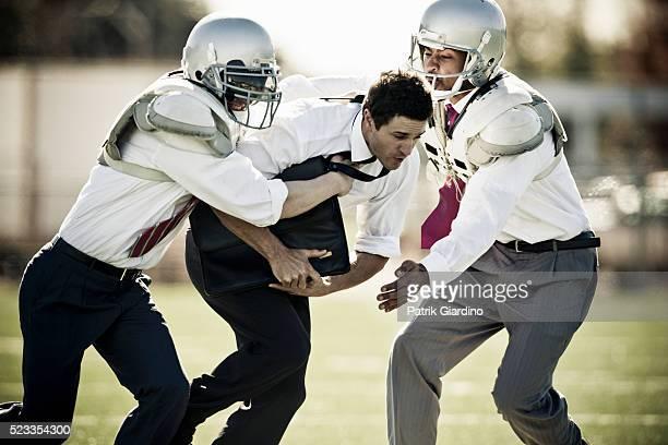 Businessmen Playing Football