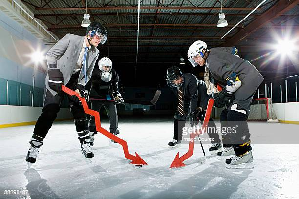 businessmen playing ice hockey - ice hockey stick stock pictures, royalty-free photos & images