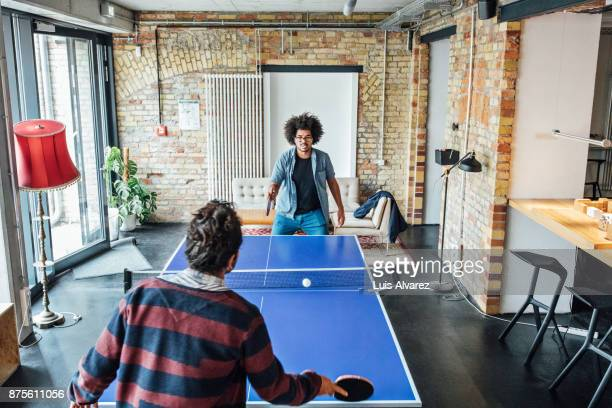 businessmen playing table tennis - table tennis stock pictures, royalty-free photos & images