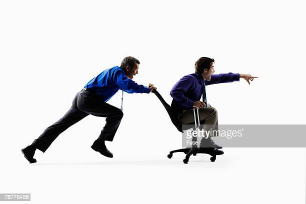 Businessmen Playing with Office Chair