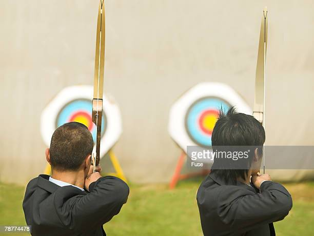 Businessmen Practicing Archery
