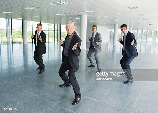 businessmen practicing t'ai chi - fighting stance stock pictures, royalty-free photos & images