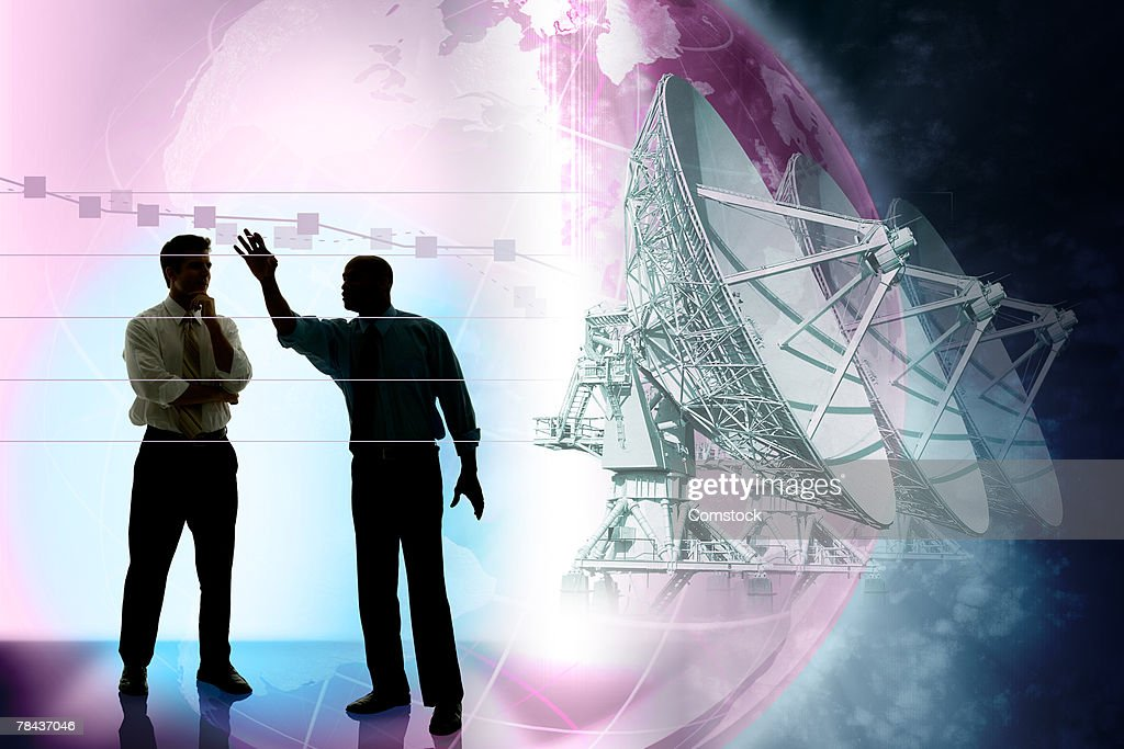 Businessmen presenting chart with satellites and globe in background : Stockfoto