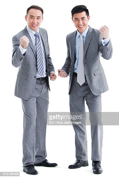 businessmen punching the air - ガッツポーズ ストックフォトと画像