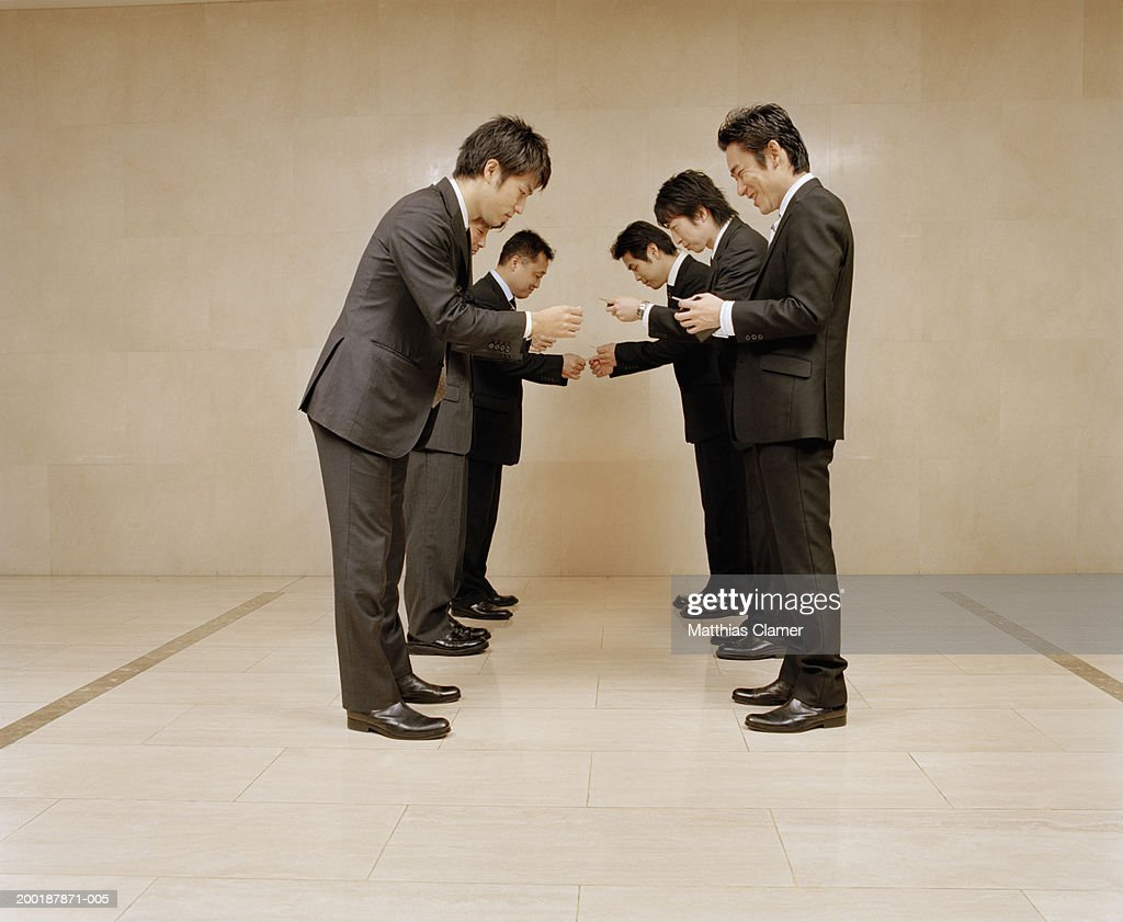 Businessmen Reading Each Others Business Cards Side View Stock ...