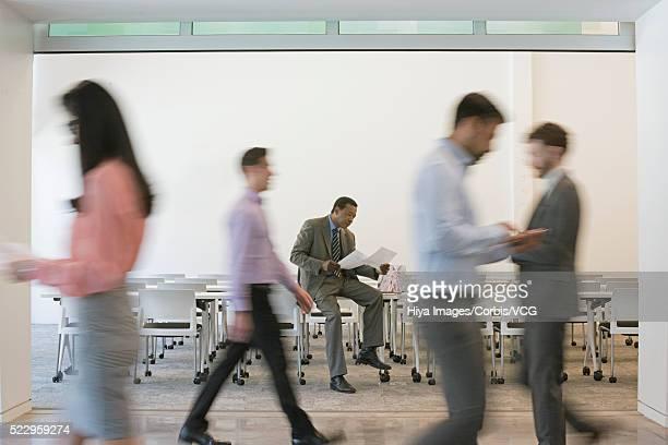 Businessmen reading in cafeteria