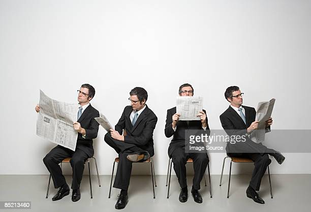 businessmen reading newspaper - reading glasses stock pictures, royalty-free photos & images