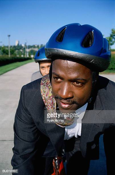 Businessmen Riding a Tandem Bicycle