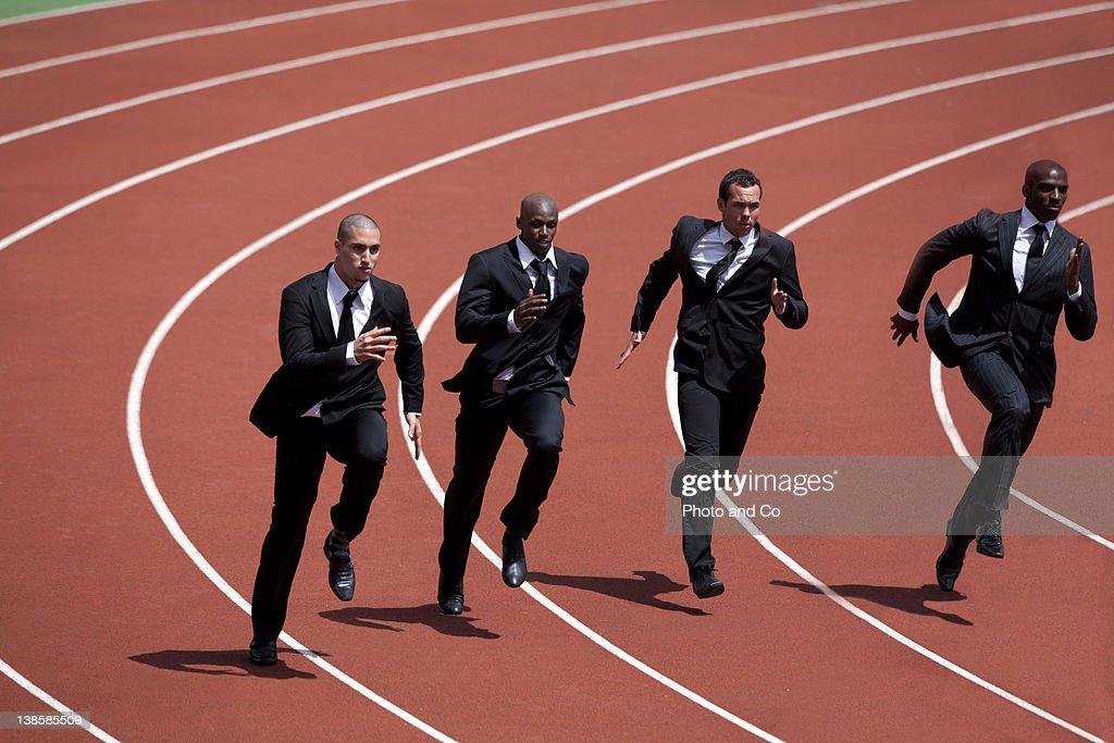 Businessmen runnin g on track : Stock Photo