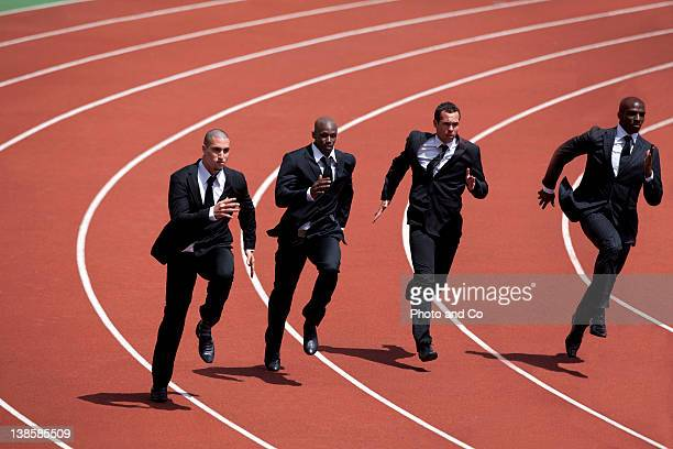 businessmen runnin g on track - contest stock pictures, royalty-free photos & images