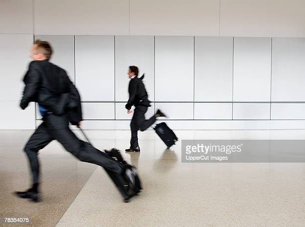 Businessmen running with suitcases