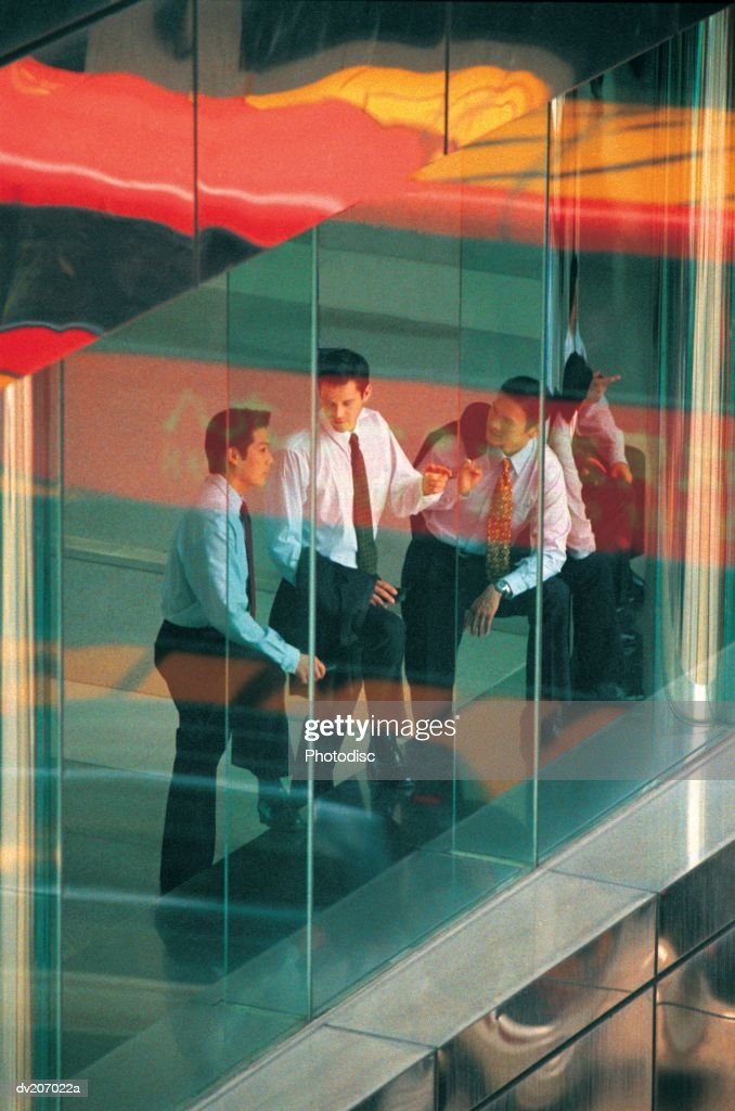 Businessmen seen through window : Stock Photo