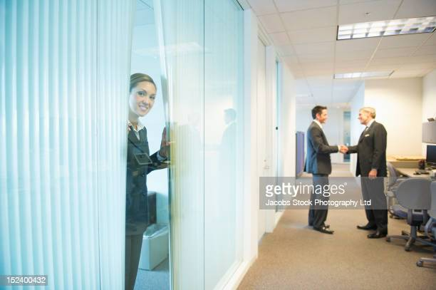 businessmen shaking hands in office - sells arizona stock pictures, royalty-free photos & images