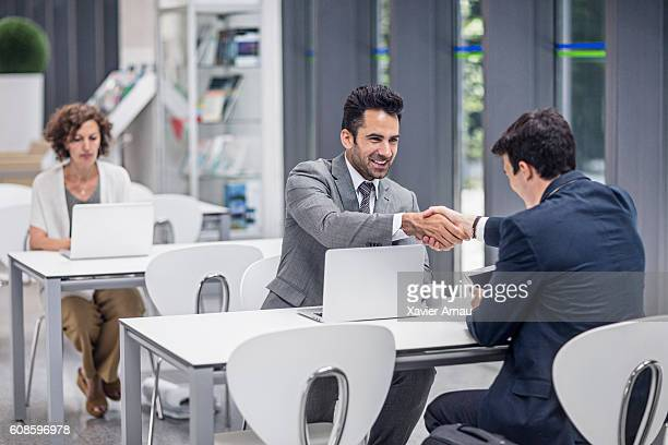 Businessmen shaking hands in the airport