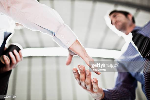 businessmen shaking hands - anticipation stock pictures, royalty-free photos & images