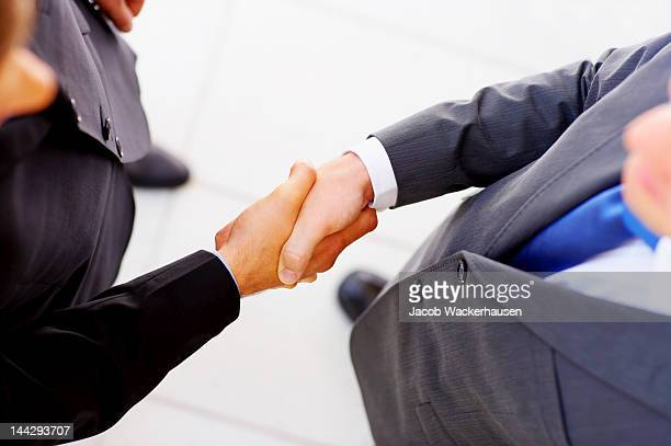 businessmen shaking hands - trade union stock pictures, royalty-free photos & images