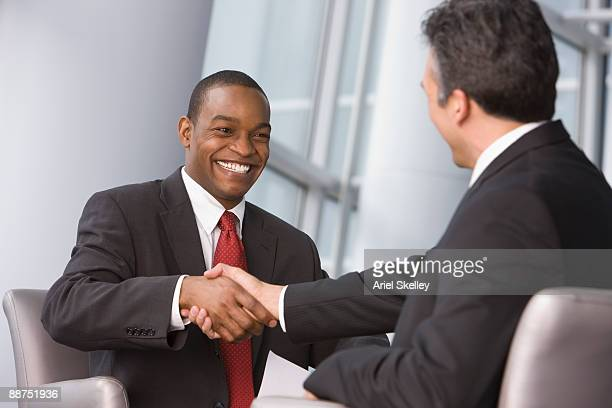 businessmen shaking hands - chairperson stock pictures, royalty-free photos & images