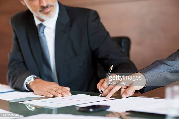 Businessmen signing paperwork