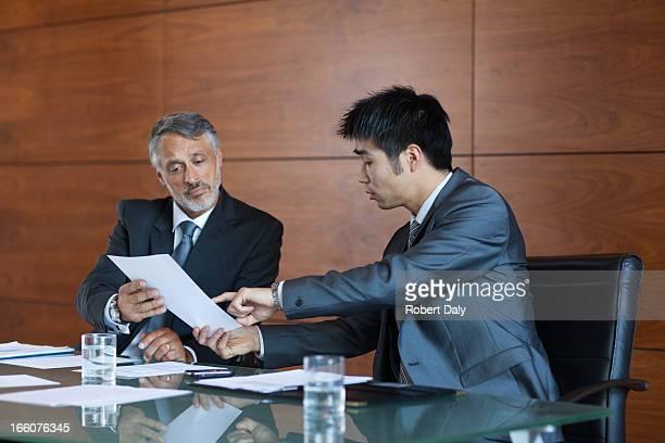 Businessmen signing paperwork