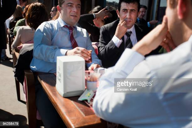 Businessmen sitting for a lunch down at the Galata Bridge on October 14, 2009 in Istanbul, Turkey. The Turkish metropolis on the Bosphorus, in the...