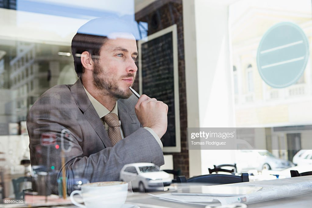 Businessmen sitting in cafe : Stock Photo