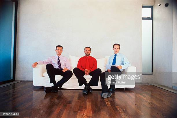Businessmen sitting on couch in office