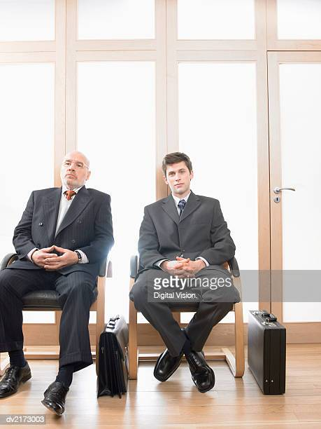 businessmen sitting side by side in chairs - legs crossed at ankle stock pictures, royalty-free photos & images