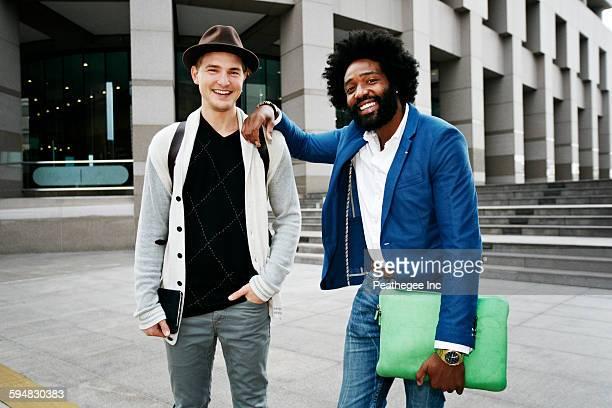 Businessmen smiling in courtyard