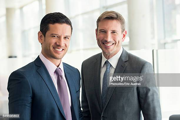 Businessmen smiling, portrait