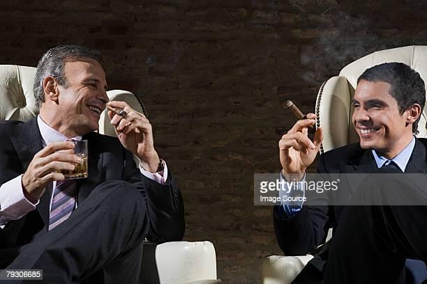 Businessmen smoking cigars