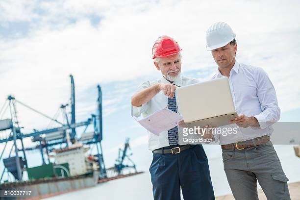 businessmen speaking about construction - marine engineering stock photos and pictures