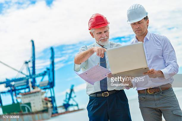 Businessmen speaking about construction