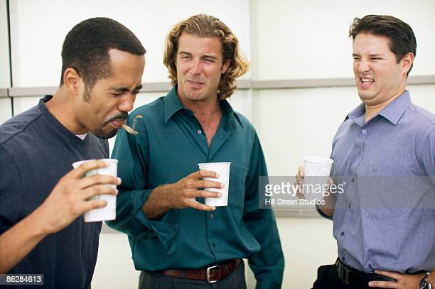 businessmen spitting out disgusting coffee - ugly black men stock photos and pictures