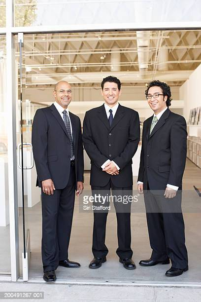 Businessmen standing at doorway of office