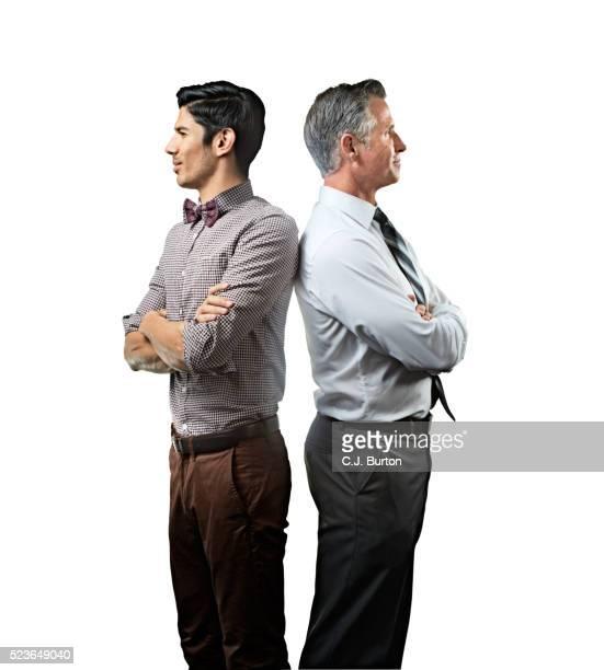 Businessmen standing back to back