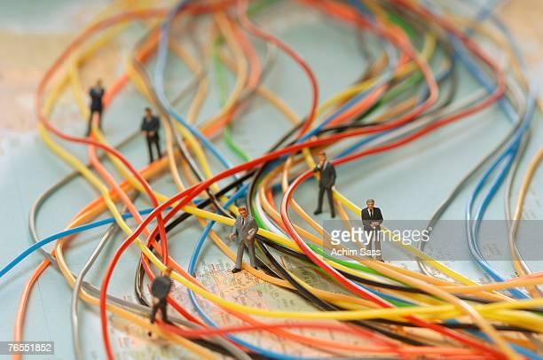 Businessmen standing between plastic wires