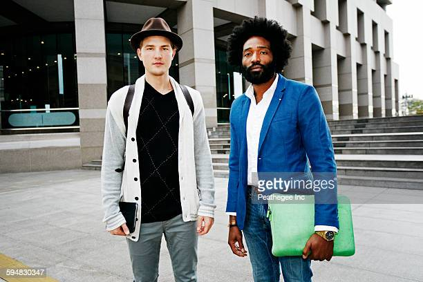 Businessmen standing in courtyard