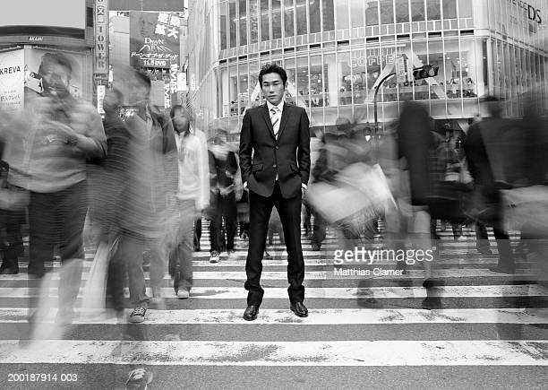 Businessmen standing in crosswalk (long exposure, B&W))