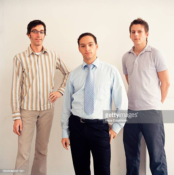 Businessmen standing in office, portrait