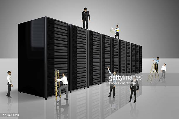 Businessmen standing on a group of data servers