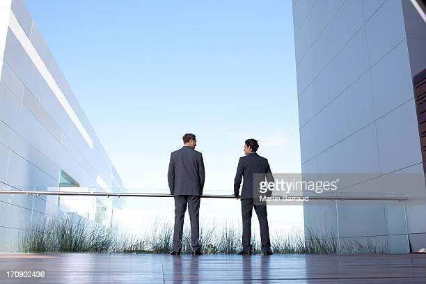 Businessmen standing on balcony