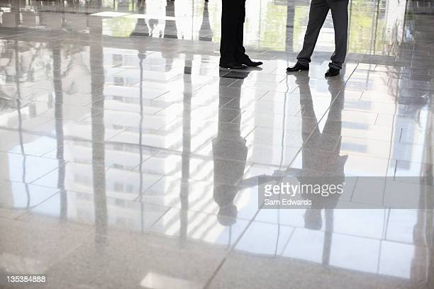Businessmen standing together in lobby