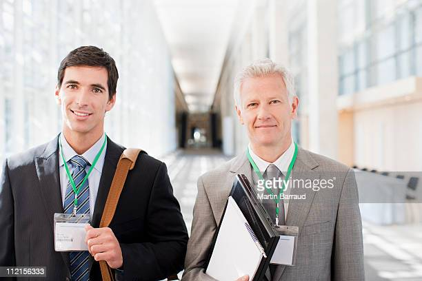 Businessmen standing together in office