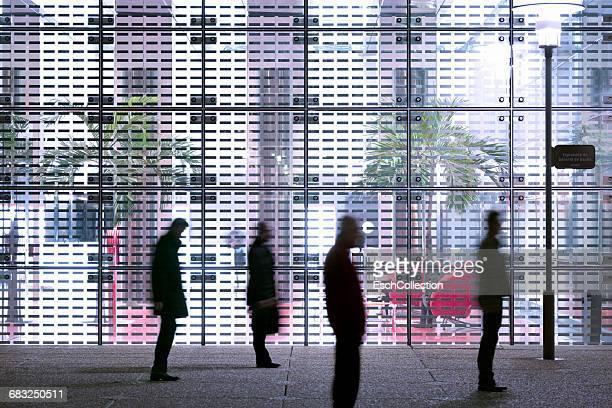 Businessmen stuck in front of modern office