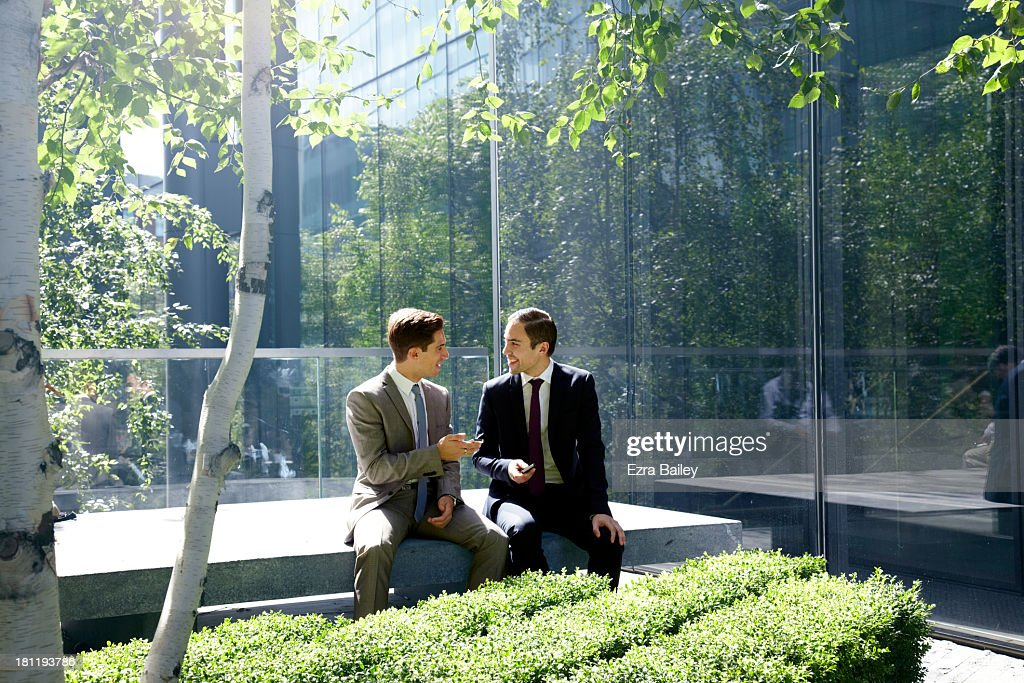 Businessmen surrounded by trees. : Stock Photo