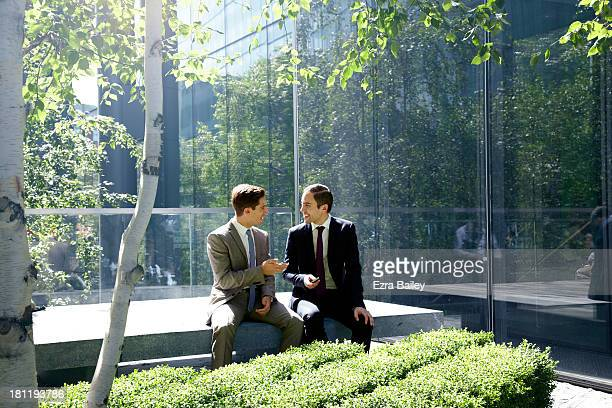 Businessmen surrounded by trees.