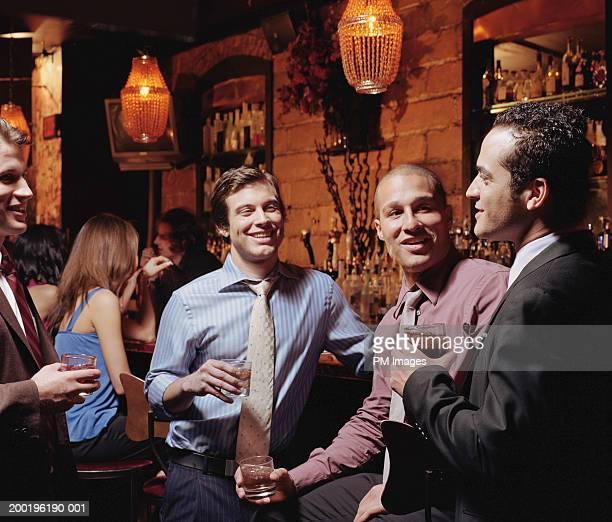 Businessmen talking at bar