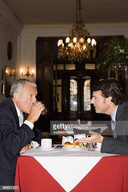 Businessmen talking at restaurant