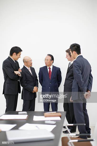 Businessmen talking by table