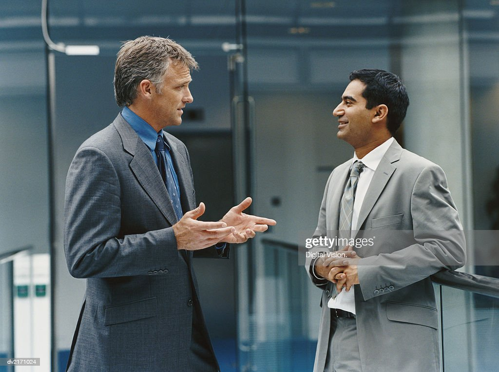 Businessmen Talking in an Office Building : Stock Photo